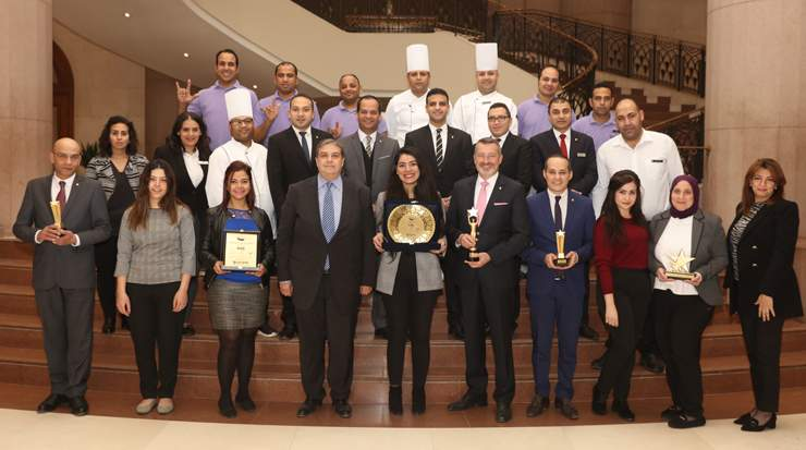 HR team with Dieter Franke and Nasser Fadly holding the awards